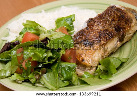 close up of fish with salad