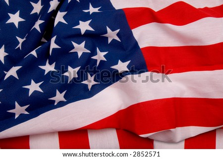 Close up of flag of the United States of America with folds and wrinkles
