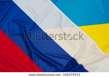Close up of flags of Ukraine and Russia - stock photo