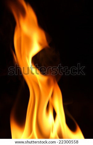 Close-up of flame on black background