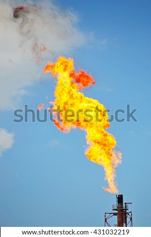 Close up of flare stack at Oil and Gas Refinery Plant - stock photo