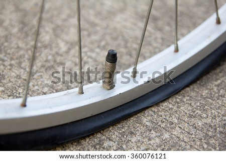 Close up of flat bicycle tire  - stock photo