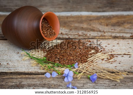Close-up of flax seeds on wooden table - stock photo