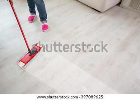 Close up of floor cleaning action with wiper - stock photo