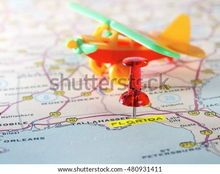 Close up of  Florida  USA map with red pin and airplane  toy - Travel concept