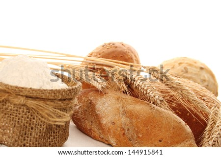 Close-up of flour in a bag and different types of bread. Isolate