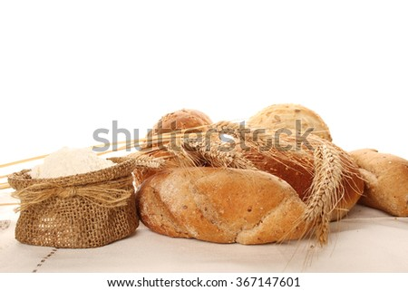 Close-up of flour in a bag and different types of bread. Isolate - stock photo