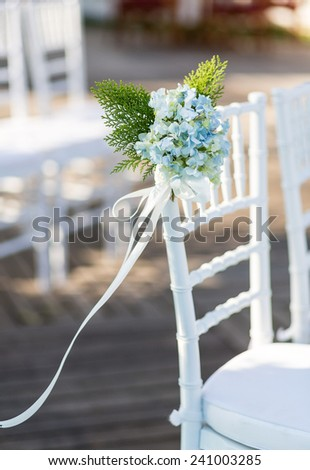 Close up of flower decorated on wedding chair - stock photo