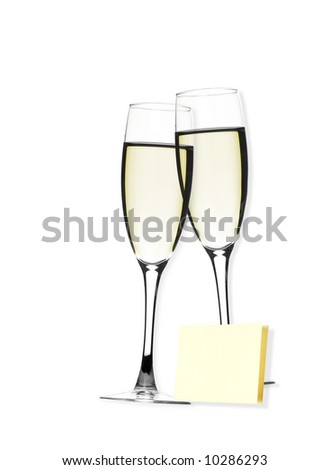 Close-up of fluted champagne glass with postit