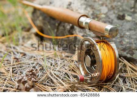 Close-up of Fly-Fishing Reel and Rod with Selective Focus - stock photo
