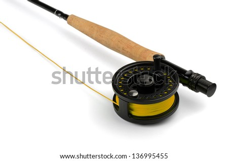 Close up of fly fishing rod and reel isolated on white - stock photo