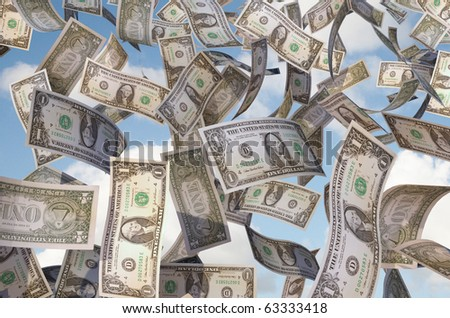 close up of flying dollar bills - stock photo