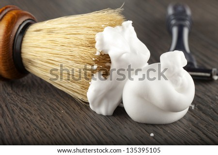 Close up of foam and brush, with razor on the back - stock photo