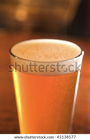 Close-up of Foam on Glass of Beer. Vertical shot. - stock photo