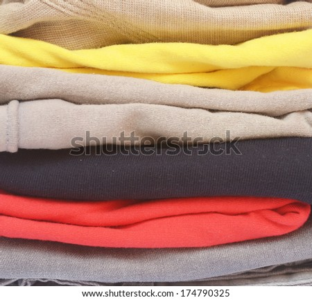close up of folded color clothes - stock photo