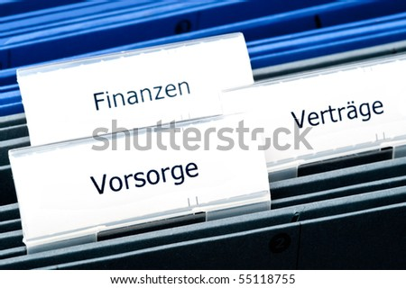 Close-up of folders precautionary labeling / finance / contracts,