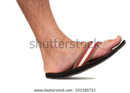 Close up of foot in flip flop - left foot - stock photo