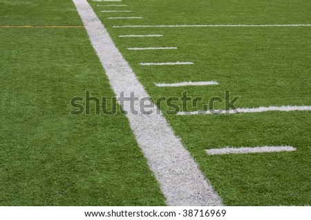 Close up of football sideline on artificial turf field