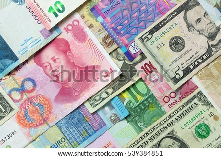 Close up of foreign currency banknotes forming background