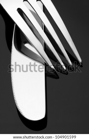 Close-up of fork and knife - stock photo