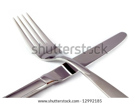 close-up of fork and knife isolated on white background - stock photo