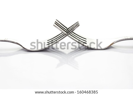 Close up of fork isolated over white background with a little shadow - stock photo