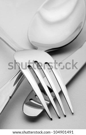 Close-up of fork, spoon and knife - stock photo