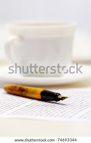 Close-up of fountain pen on document at workplace - stock photo