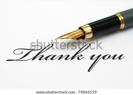 Close up of fountain pen on thank you - stock photo