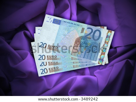 close-up of four 20 Euro banknotes lying on satin background