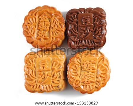 Close up of four mooncakes isolated on white background. (The chinese words indicates the type of mooncake, not the brand)