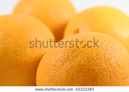 Close up of four oranges.