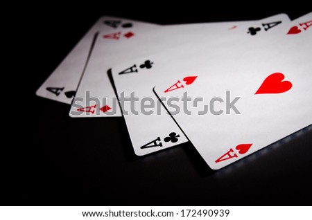 close up of four poker cards on black background - stock photo