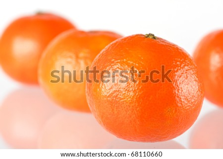 close up of four tangerine