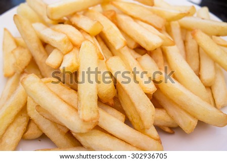 close up of french fries on white plate - stock photo