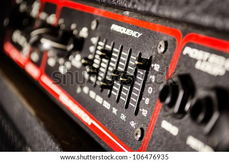 close up of frequency fader on a amplifier head - stock photo