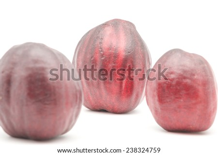 Close up of fresh and ripe rose apple or chompoo tropical thai fruit on white background - stock photo