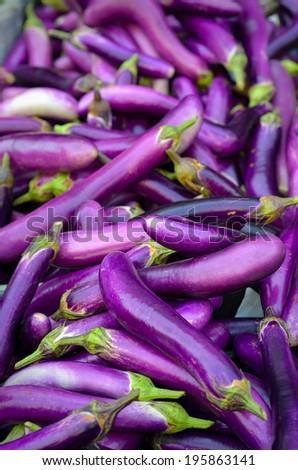 Close up of fresh aubergines (eggplant), selective focus. - stock photo
