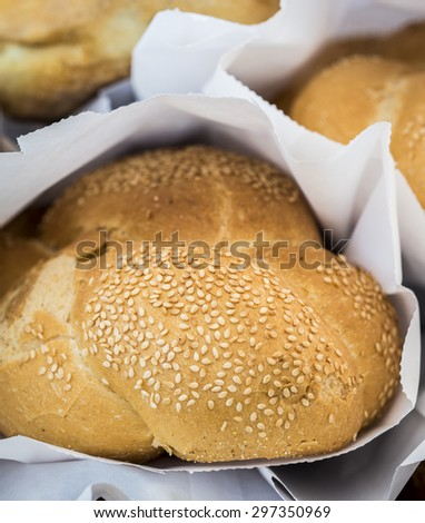 Close-up of fresh baguette read to sell. - stock photo