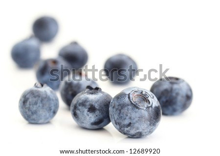 Close-up of fresh blueberries on white background. Selective focus.