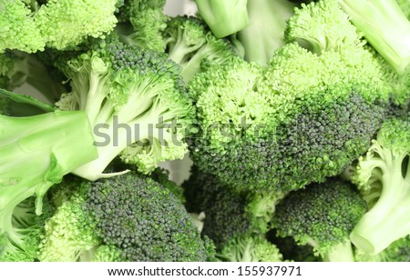 Close up of fresh broccoli in a pile. Whole background.