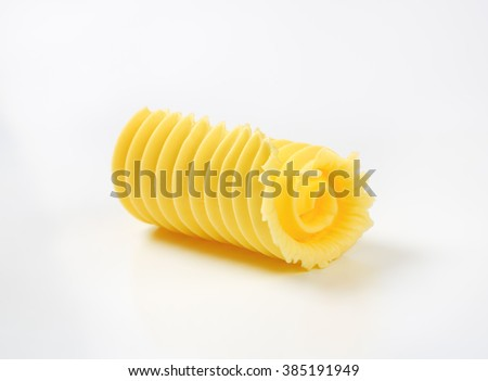 close up of fresh butter curl on white background