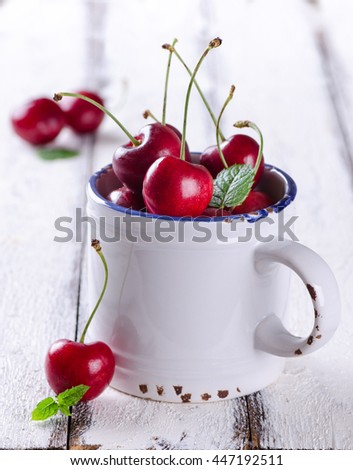Close up of fresh cherries in a cup