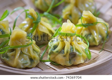 Close up of fresh Chinese steamed dumplings - stock photo