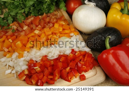 Close up of fresh cut and whole vegetables - stock photo