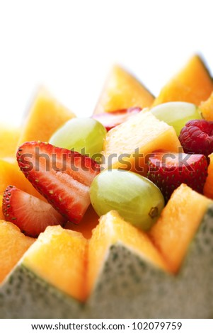Close-up of Fresh Fruit Salad in Cantaloupe Bowl (Selective focus)