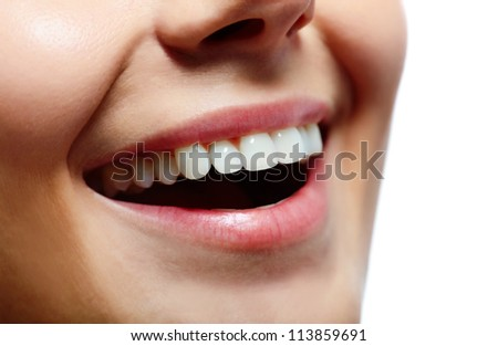 Close-up of fresh girl with healthy white teeth smiling - stock photo