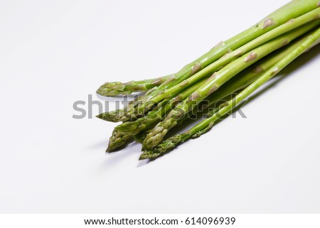 Close up of fresh green asparagus on white background