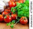 Close up of fresh herbs,tomatoes and garlic - stock photo
