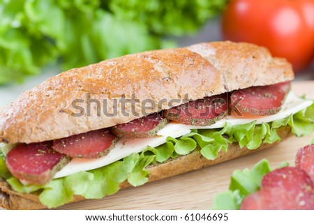 Close up of fresh homemade sandwiches on wooden board - stock photo